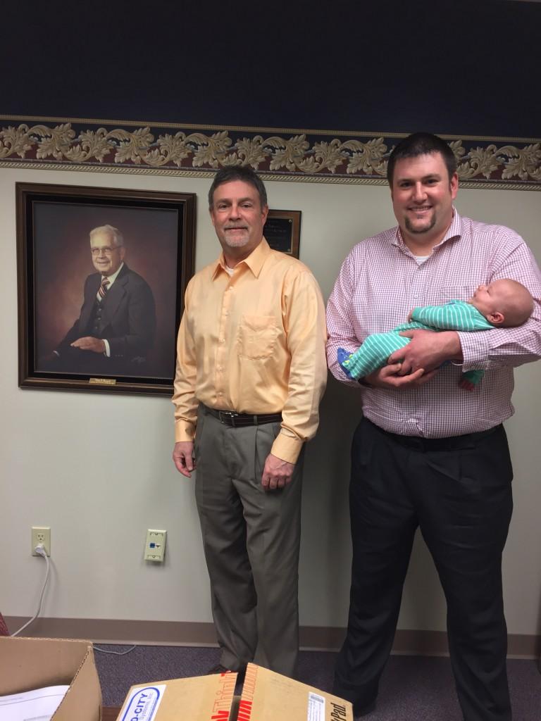 Willis Boswell (founder), Michael Boswell, President, Erik Boswell, VP holding his newborn son Layton